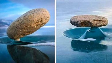 Photo of Baikal Zen Phenomenon. These Stones Are Held In Balance As If By Magic On The Frozen Lake