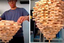 Photo of He Stacks Over 1,500 Jenga Blocks On A Single Brick: He Broke His Own World Record.