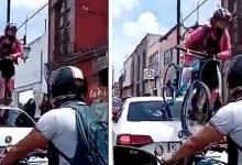 Photo of A Car Blocks A Cycle Lane: A Girl Takes Revenge By Climbing To The Roof With Her Bicycle.